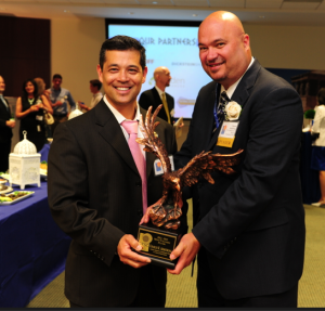 Mr. Guy Torres, Director of Information Technology Contracting at U.S. Customs and Border Protection, with GTSC's 2013 MVP Awardee, Mr. Charles R. Armstrong, Assistant Commissioner and Chief Information Officer at U.S. Customs and Border Protection.